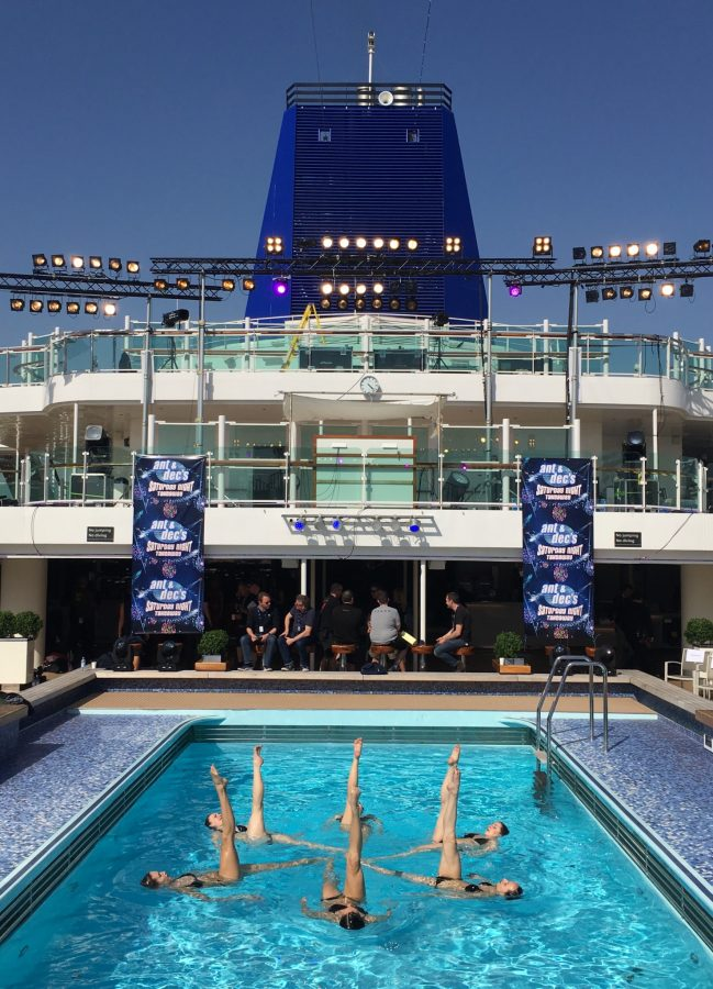 Eight synchronised swimmers performing on the Britannia cruise ship