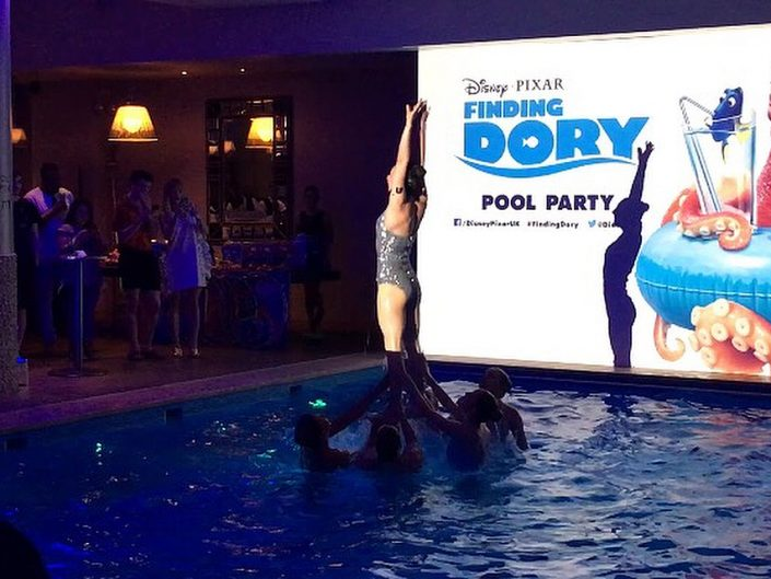 Aquabatix perform at the Disney Finding Dory pool party event