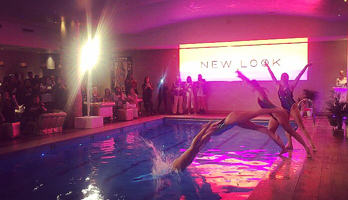 Aquabatix synchronised swimmers perform to launch the New Look SS17 pool to party range