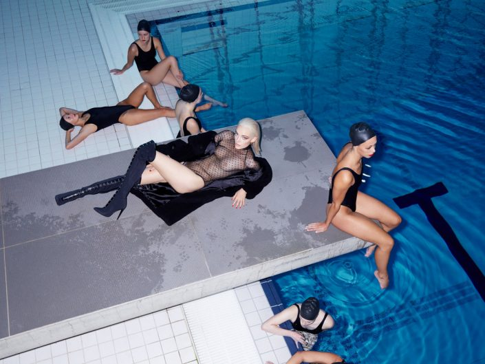Vogue cover model Nimue poses with Aquabatix synchronised swimmers