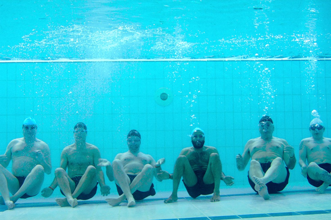 Swimming with men underwater