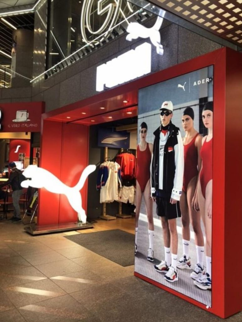 Puma store front synchronised swimmers