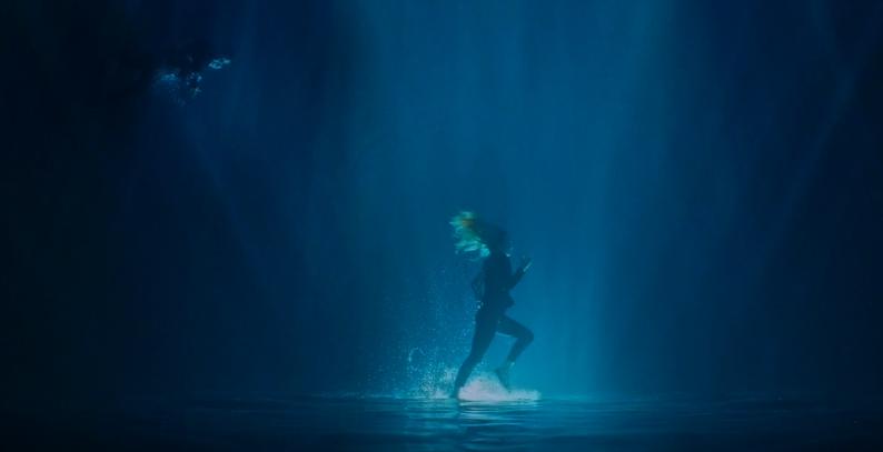 Aquabatix underwater model runs upside down underwater in ROMANS music video